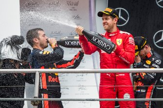 Sebastian Vettel, Ferrari, 2nd position, sprays Champagne on the podium