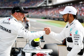 Polesitter Lewis Hamilton, Mercedes AMG F1, third place Valtteri Bottas, Mercedes AMG W10