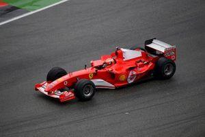Mick Schumacher, Ferrari F2004 waves to the crowd