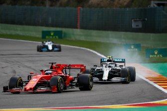 Sebastian Vettel, Ferrari SF90, leads Valtteri Bottas, Mercedes AMG W10