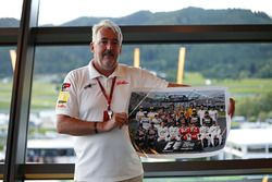 Mark Sutton, F1 Photographer with the signed F1 driver group photo to be auctioned in aid of Great Ormond Street Hospital
