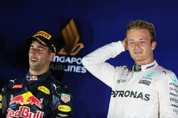 The podium (L to R): second placed Daniel Ricciardo, Red Bull Racing and race winner Nico Rosberg, M