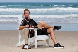 Will Davison, Tekno Autosports Holden with the Peter Brock Trophy at Narrowneck Beach