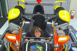 Jane Wilson, Justin Wilson's daughter, sitting in Uncle Stefan Wilson, KV Racing Technology Chevrolet's IndyCar