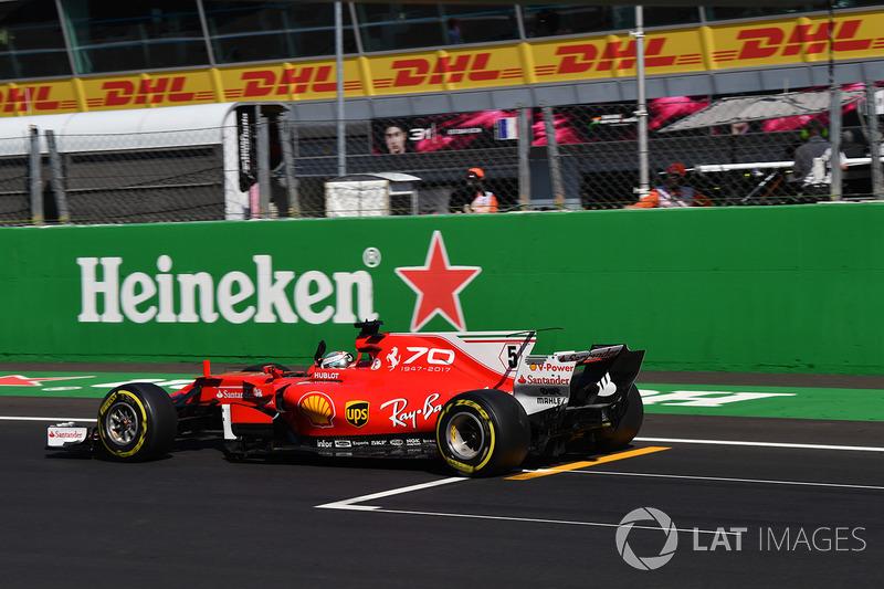 Sebastian Vettel, Ferrari SF70H celebrates as he crosses the line for third