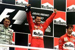Podium: Race winner Michael Schumacher, Ferrari; second place Mika Hakkinen, McLaren; third place Eddie Irvine, Ferrari
