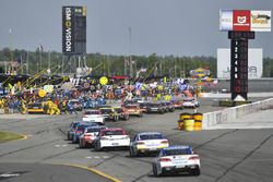 The field turns in to pit road