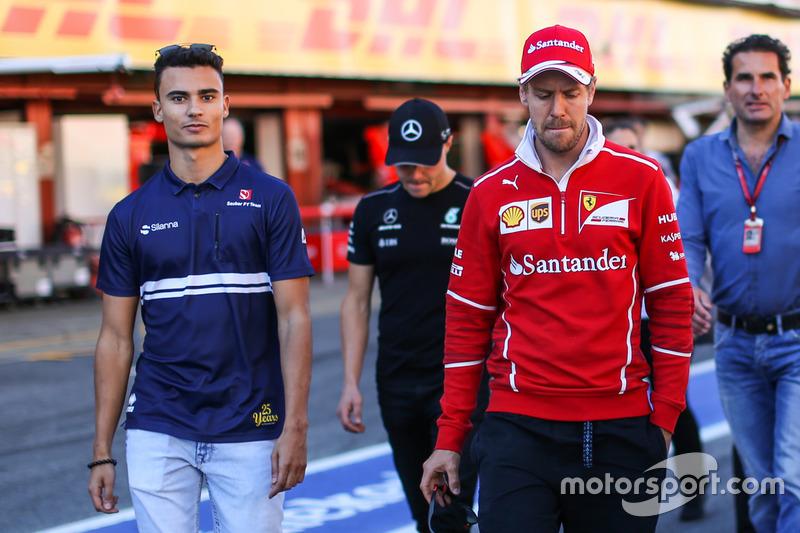 Паскаль Верляйн, Sauber, и Себастьян Феттель, Ferrari