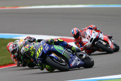 Valentino Rossi, Yamaha Factory Racing runs wide before Johann Zarco, Monster Yamaha Tech 3 makes contact