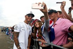 Race winner Lewis Hamilton, Mercedes AMG F1, signs autographs for fans