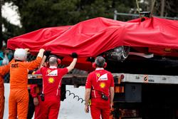 The crashed Ferrari SF70H of Kimi Raikkonen, Ferrari is recovered back to the pits on the back of a