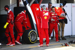 A Pirelli tyre from a Ferrari s wheeled by a mechanic in the pit lane