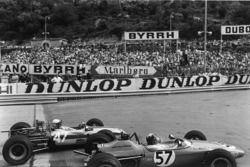 Natalie Goodwin, Brabham BT21-Ford passes Francois Mazet, Tecno 69 - Ford