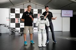 Sébastien Bourdais and Charlie Kimball with Asimo