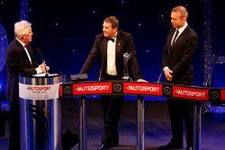 Nigel Mansell op het podium met Sir Chris Hoy en Steve Rider na het ontvangen van de Gregor Grant Aw