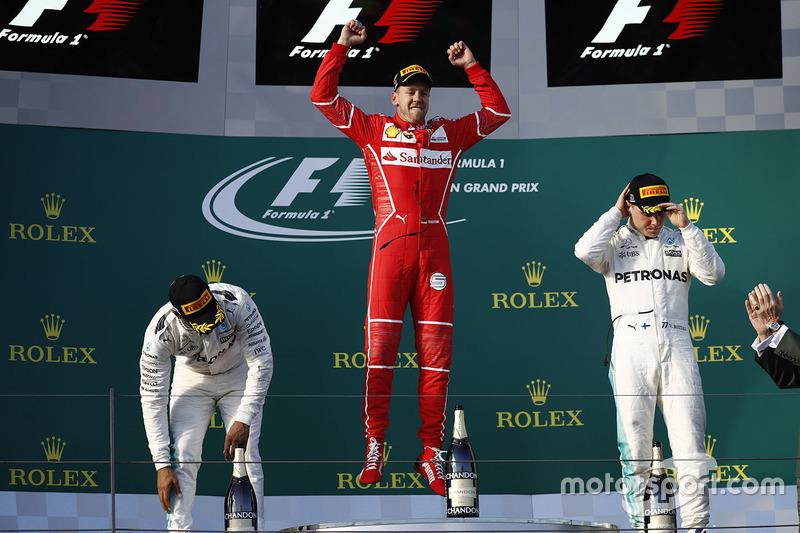 Podium: winner Sebastian Vettel, Ferrari, second place Lewis Hamilton, Mercedes AMG F1, third place Valtteri Bottas, Mercedes AMG F1