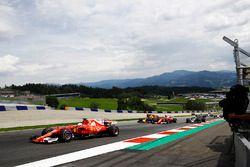Sebastian Vettel, Ferrari SF70H lead Daniel Ricciardo, Red Bull Racing RB13, Kimi Raikkonen, Ferrari