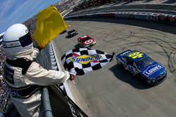 Jimmie Johnson, Hendrick Motorsports Chevrolet, takes the checkered flag in front of Kyle Larson, Chip Ganassi Racing Chevrolet