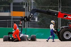 Marcus Ericsson, Sauber C36, walks away from his beached car as Marshals work to remove it