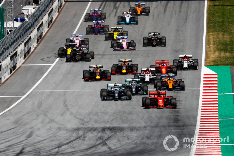Charles Leclerc, Ferrari SF90, leads Valtteri Bottas, Mercedes AMG W10, Lewis Hamilton, Mercedes AMG F1 W10, Lando Norris, McLaren MCL34, Kimi Raikkonen, Alfa Romeo Racing C38, Sebastian Vettel, Ferrari SF90, Max Verstappen, Red Bull Racing RB15, and the rest of the field at the start