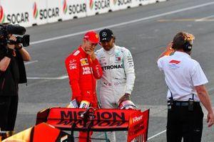 Sebastian Vettel, Ferrari, et Lewis Hamilton, Mercedes AMG F1, après les qualifications
