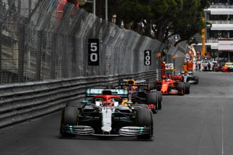 Lewis Hamilton, Mercedes AMG F1 W10, leads Max Verstappen, Red Bull Racing RB15, and Sebastian Vettel, Ferrari SF90