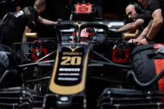 Kevin Magnussen, Haas F1 Team VF-19, is returned to the garage by mechanics