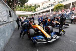 Lando Norris, McLaren MCL34, and Carlos Sainz Jr., McLaren MCL34, arrive on the grid