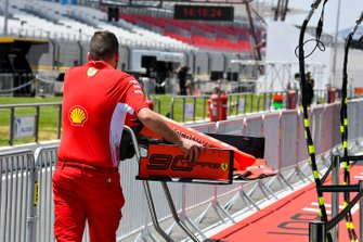 Ferrari mechanic pushing the front wing of a Ferrari SF90