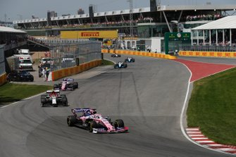 Sergio Perez, Racing Point RP19, leads Antonio Giovinazzi, Alfa Romeo Racing C38, and Lance Stroll, Racing Point RP19