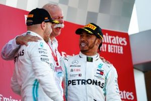 Valtteri Bottas, Mercedes AMG F1, 2nd position, Dr Dieter Zetsche, CEO, Mercedes Benz, and Lewis Hamilton, Mercedes AMG F1, 1st position, celebrate on the podium