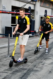 Daniel Ricciardo, Renault F1 Team and Nico Hulkenberg, Renault F1 Team plays on a scooter in the pit lane
