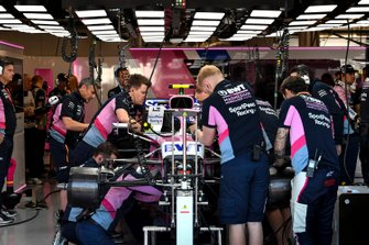 Car of Lance Stroll, Racing Point RP19 being worked on my mechanics