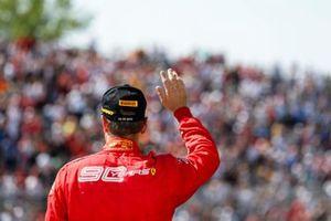 Sebastian Vettel, Ferrari waves to fans on the podium