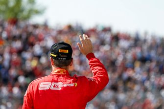 Sebastian Vettel, Ferrari waves to fans on the podium