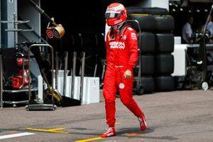 Sebastian Vettel, Ferrari walks back to his garage after crashing