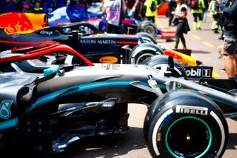 Cars of Valtteri Bottas, Mercedes AMG W10 and Pierre Gasly, Red Bull Racing RB15 lined up in the pit lane