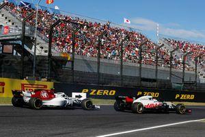 Kevin Magnussen, Haas F1 Team VF-18, za nim Charles Leclerc, Sauber C37