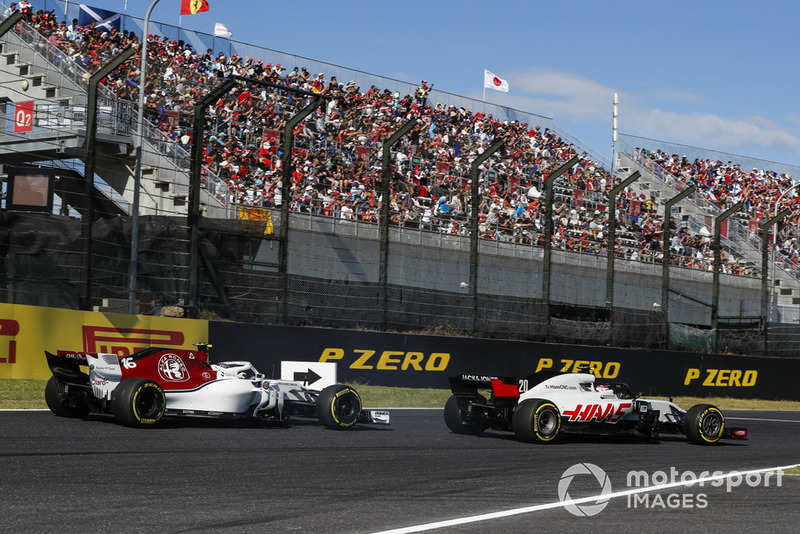 Leclerc and Magnussen clash on lap 2