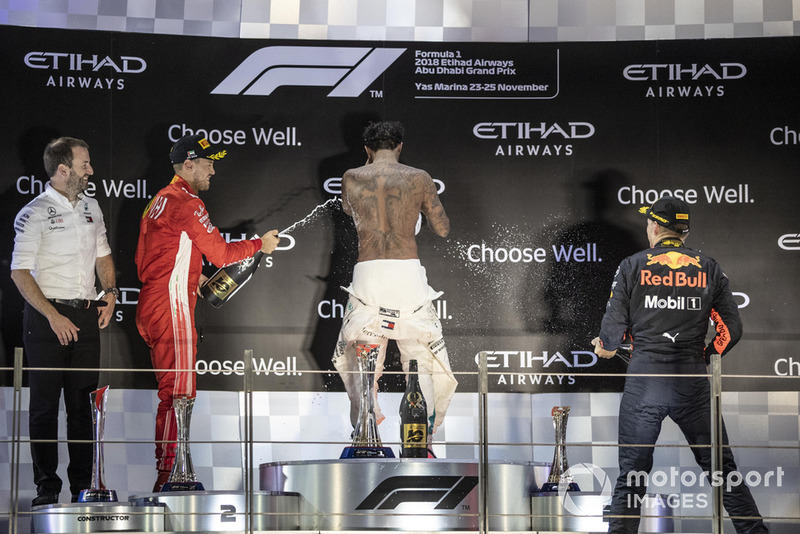 Bradley Lord, Head of Mercedes-Benz Motorsport Communications, Sebastian Vettel, Ferrari, Lewis Hamilton, Mercedes AMG F1 and McLare celebrates on the podium with the champagne