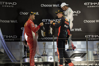 Sebastian Vettel, Ferrari and Max Verstappen, Red Bull Racing celebrate on the podium with the champagne