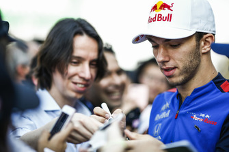 Pierre Gasly, Scuderia Toro Rosso, signs an autograph