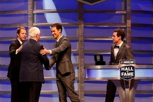 Brad Keselowski, Joey Logano and Ryan Blaney speak on stage as Roger Penske is inducted into the NASCAR Hall of Fame