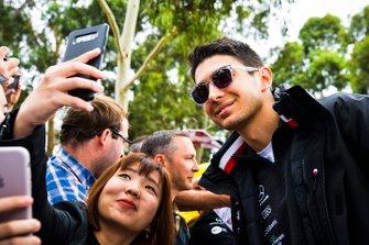 Esteban Ocon, Mercedes AMG F1, has his photo taken with a fan