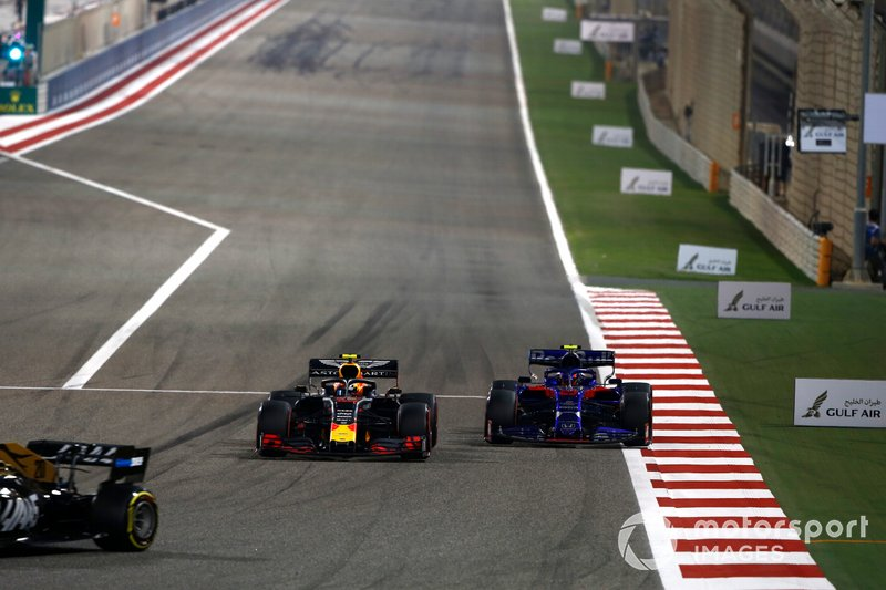 Kevin Magnussen, Haas F1 Team VF-19, leads Pierre Gasly, Red Bull Racing RB15, and Alexander Albon, Toro Rosso STR14