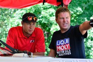 Joe Stevens of Stevens-Miller Racing talks with crew members