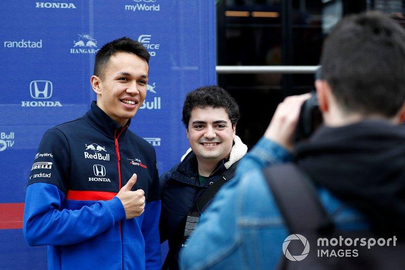 Alex Albon, Scuderia Toro Rosso poses for a photo with a fan