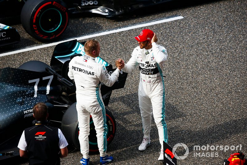 Lewis Hamilton, Mercedes AMG F1, congratulates team mate Valtteri Bottas, Mercedes AMG F1, on pole position