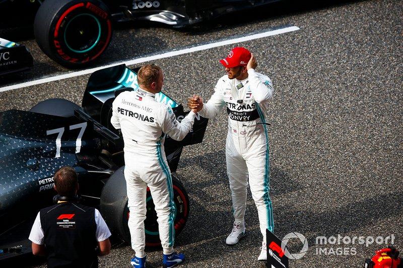 Lewis Hamilton, Mercedes AMG F1, congratulates team mate Valtteri Bottas, Mercedes AMG F1, on pole position