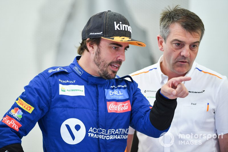 Fernando Alonso, McLaren, talks to a team member
